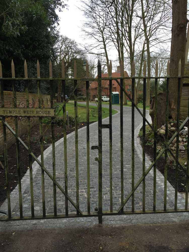 gates and granite sett driveway