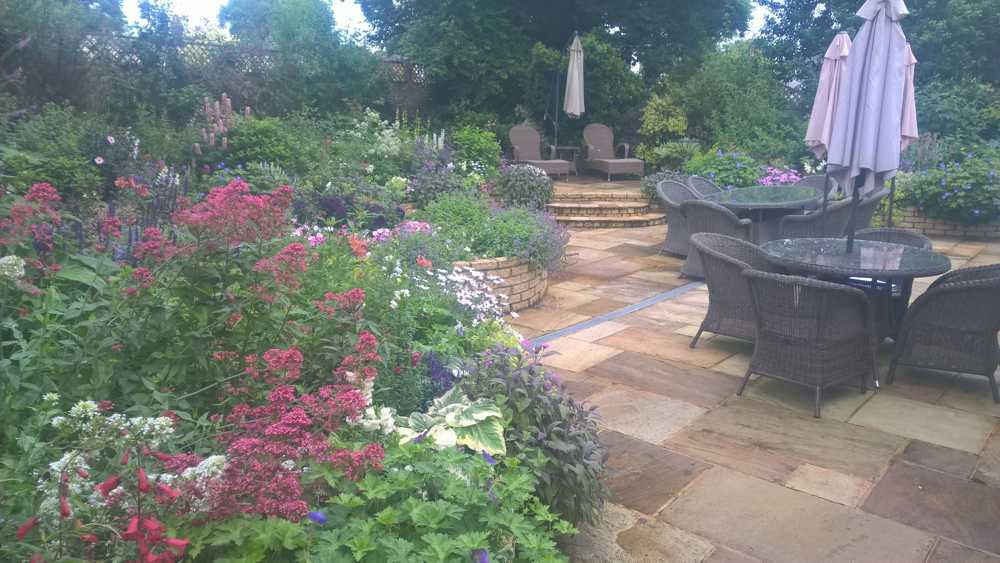 vibrant flowery garden with furniture