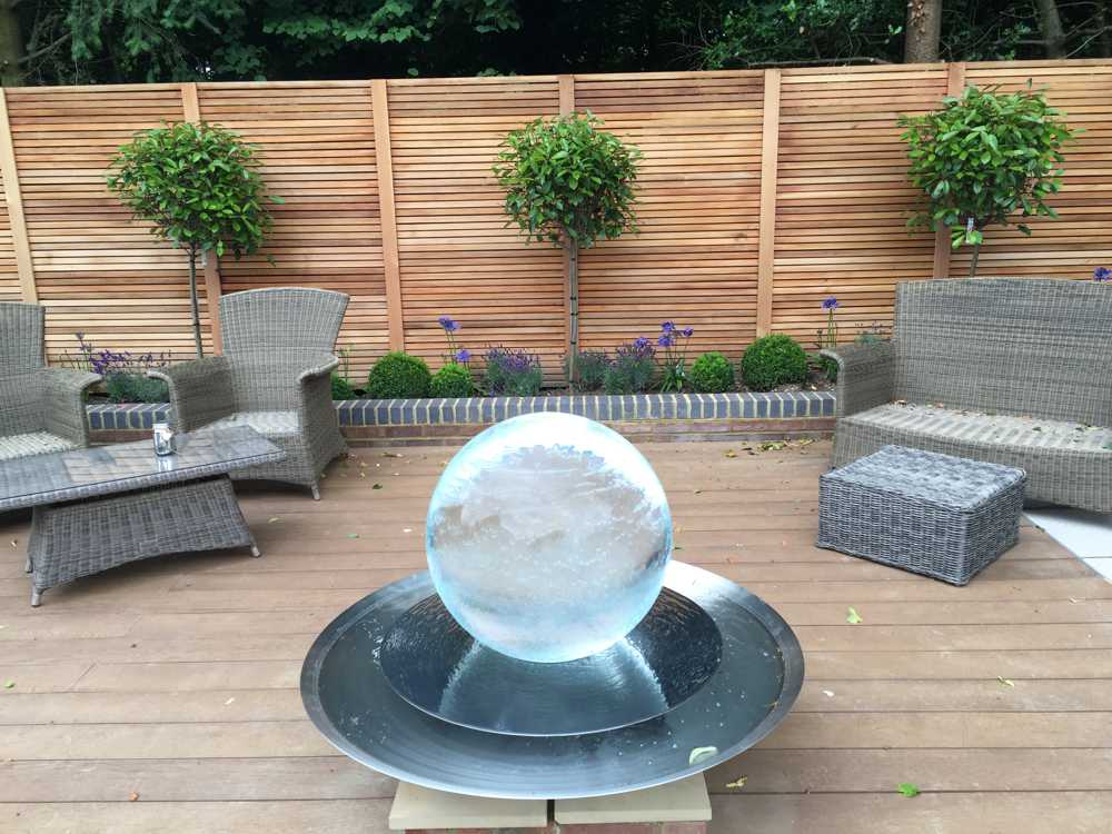 landscaped patio garden with glass feature