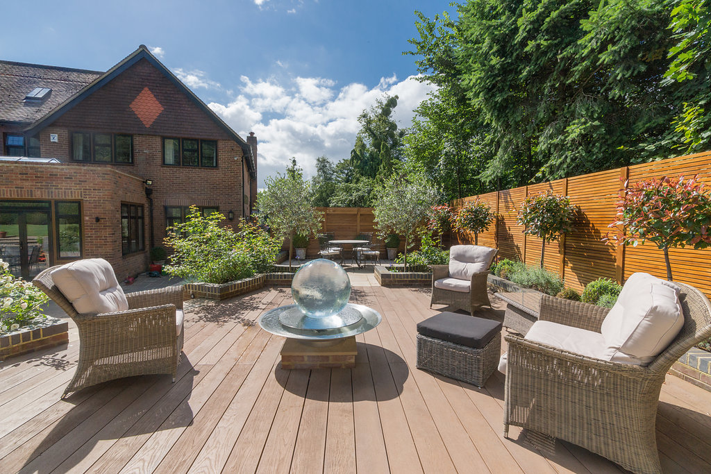 residential garden with glass feature and furniture