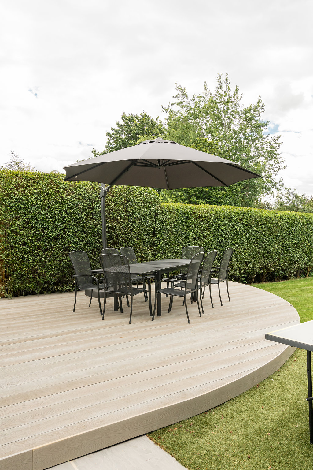 outdoor furniture on landscaped patio area