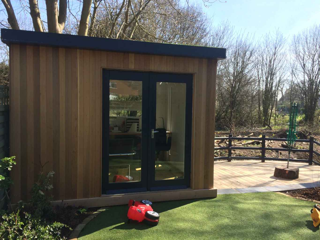 shed conversion to working space in beautiful garden