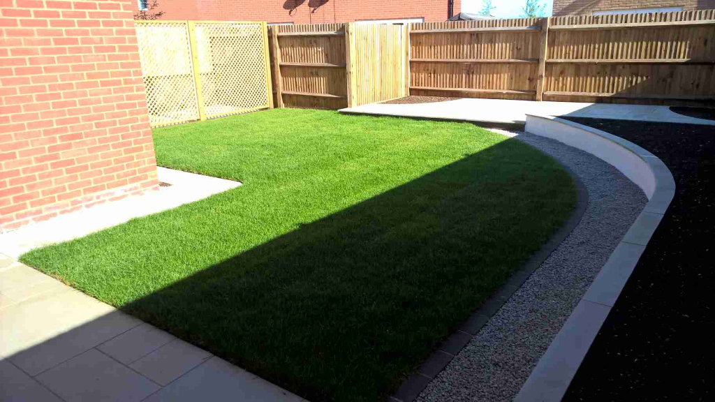 freshly laid grass with stone bordering