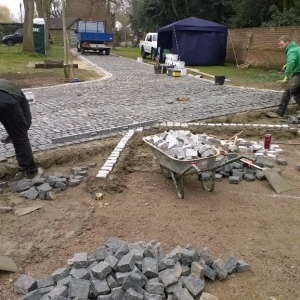 laying the granite setts for a driveway