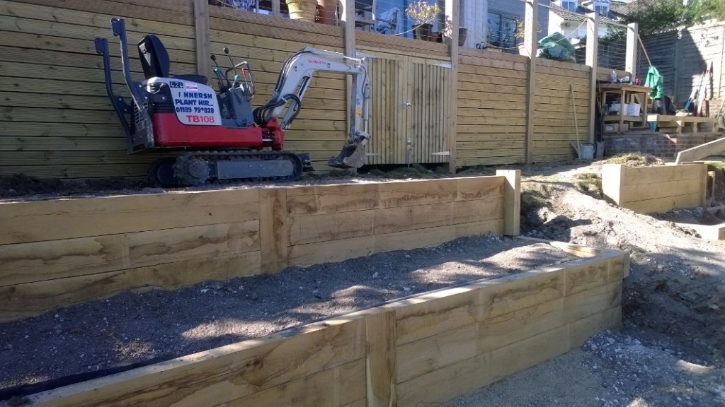 creating the tiered planting area with 270 oak sleepers
