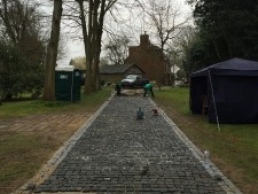 laying 26,000 individual granite setts for new driveway