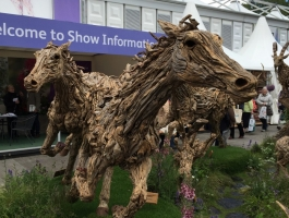 wooden horse sculptures at chelsea flower show