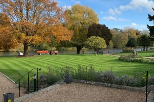 Manicured riverside lawns at Oakley Court Hotel