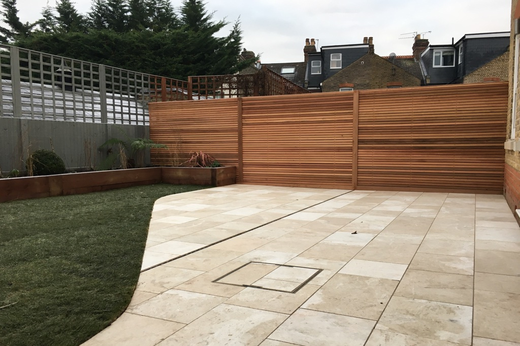 New cedar screening in landscaped garden