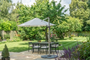 shaded outdoor dining area in landscaped garden