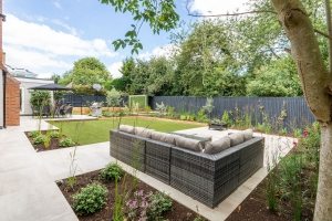 landscaped garden with children's play area