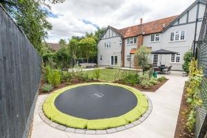 sunken trampoline in landscaped garden