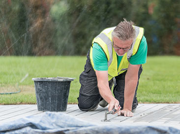 landscape gardener laying a new path
