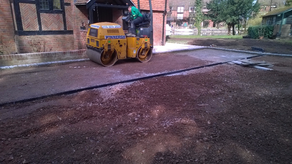 flattening the ground to lay a driveway