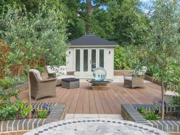decked entertainment area in landscaped garden