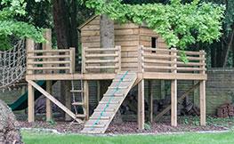 custom built children's play area in garden