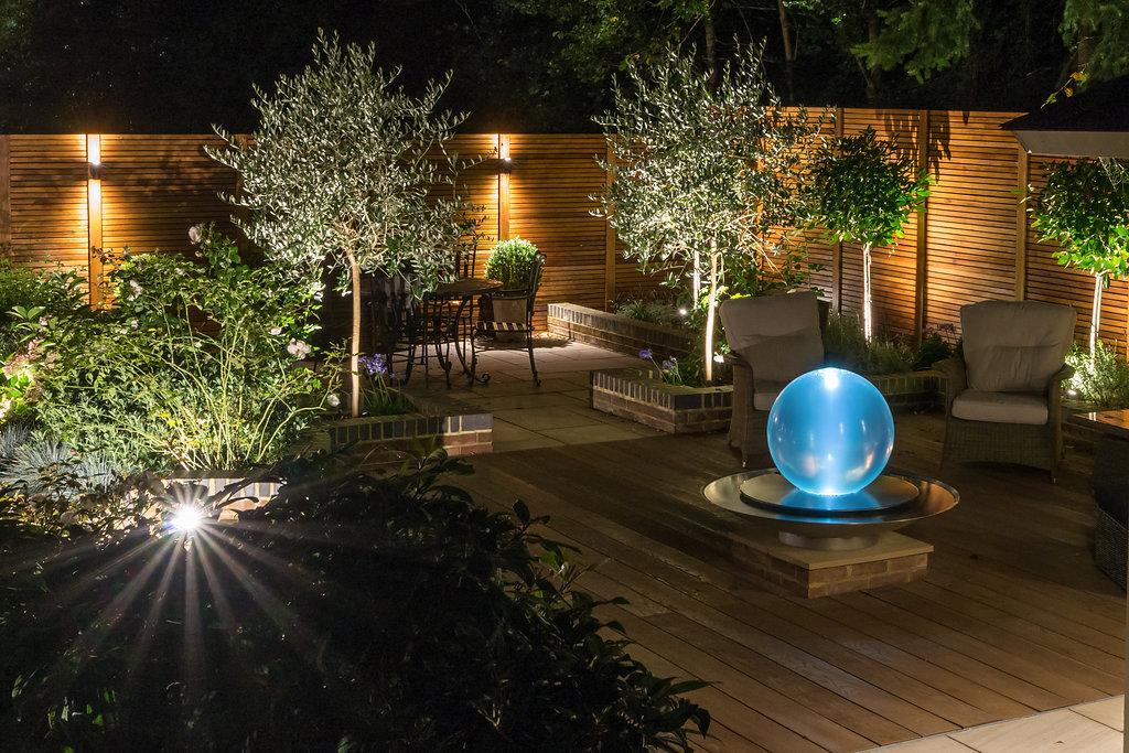 residential garden with outdoor lighting