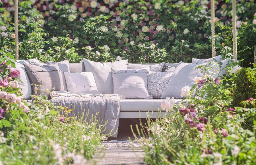 outdoor sofa in romantic garden setting
