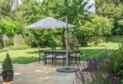 landscaped patio with shaded dining area